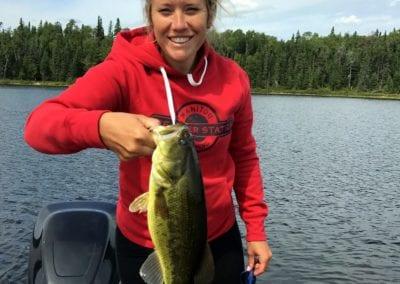 Woman largemouth bass fishing Ontario