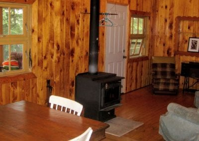 Living room with fireplace stove at the Tipperary guest Cabin